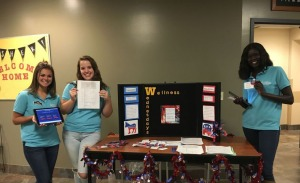 Members of the Student Prevention and Outreach Team provided information on how to become a registered voter. (Diana Russo, Staff Photographer)