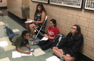 Amanda Wells, Holly Giles, Nicole Kimball and Oskarys Fermin patiently waiting for their turn to audition. (Justin Gould Staff, Photographer)