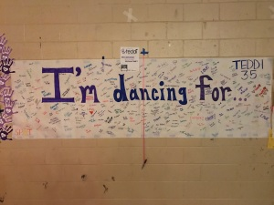 One of the many Teddi Dance For Love posters signed by those at the dance (photo by Mike Maraghi)